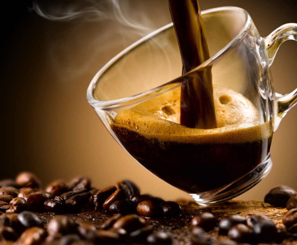 black-coffee-being-poured-into-glass