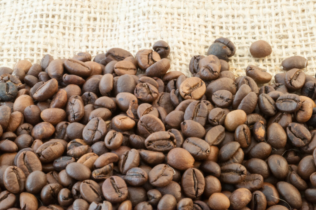 variety of coffee beans on burlap